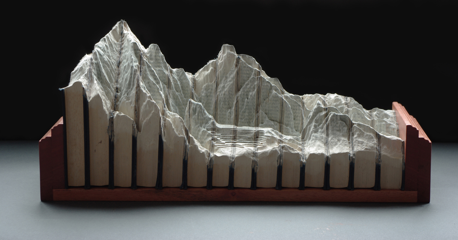 18 historia das americass1 Mind Blowing Book Sculptures by Guy Laramee