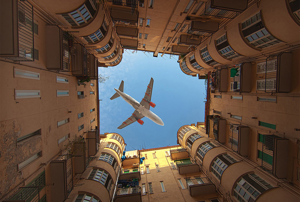 airplane over building1 25 Outstanding Examples of Machine Photography