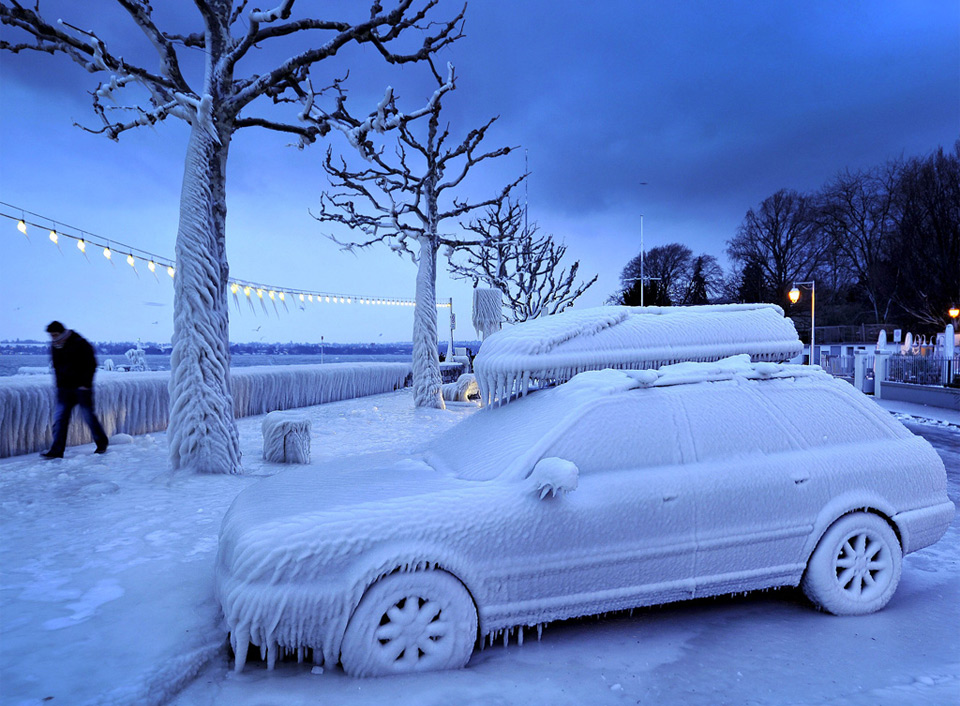 ice covered car by the frozen lake geneva1 25 Outstanding Examples of Machine Photography