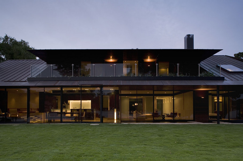 exterior view of lakehouse with glass walls Peninsula Residence On Lake Austin, Texas