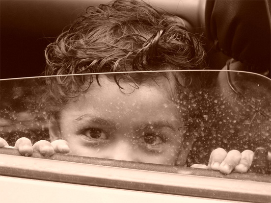 a child in a car after the rain