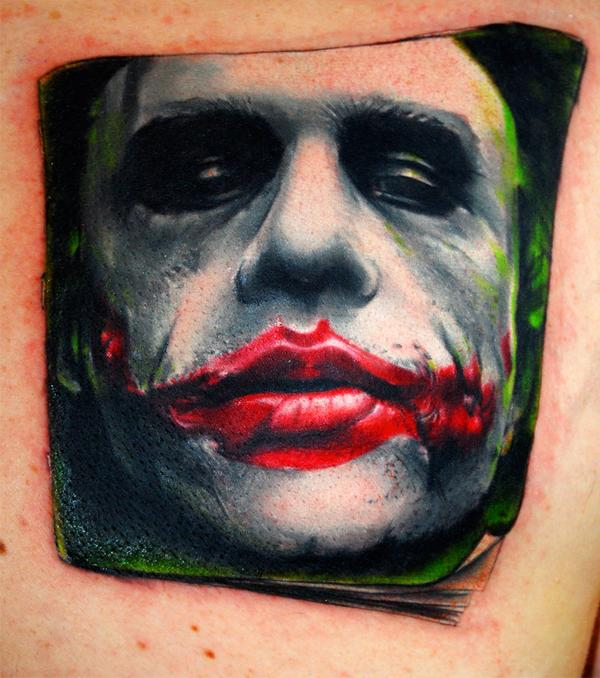 the joker tattoo by carlyshephard1 30 Incredible Tattoo Designs