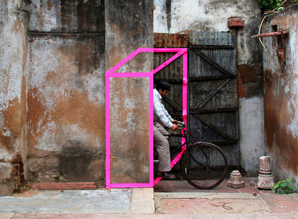 ingenious creative cubes from neon tape by aakash nihalani 13 Geometric Street Art Created With Luminescent Tape