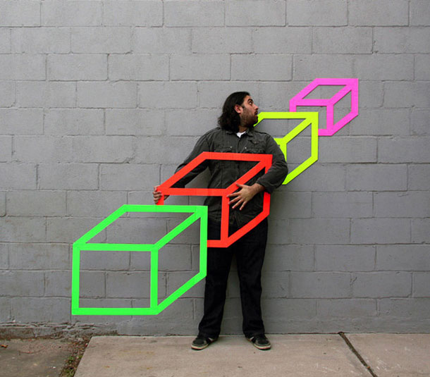 ingenious creative cubes from neon tape by aakash nihalani 15 Geometric Street Art Created With Luminescent Tape