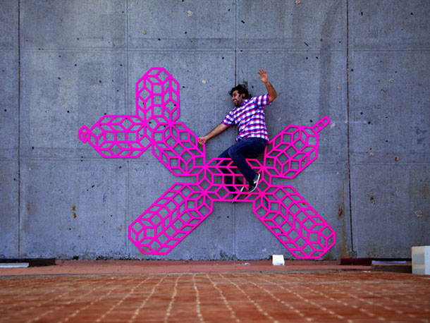 ingenious creative cubes from neon tape by aakash nihalani 24 Geometric Street Art Created With Luminescent Tape
