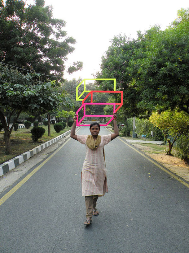 ingenious creative cubes from neon tape by aakash nihalani 27 Geometric Street Art Created With Luminescent Tape